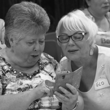 SingMe Liverpool members, Clare and Glo, up to antics on social media during a break in a SingMe Together session