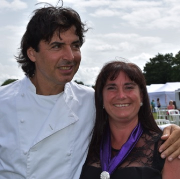 SingMe Choir Manager and Administrator, Wendy Williamson pictured here with celebrity chef, Jean Christophe Novelli at The North West Food Lover's Festival